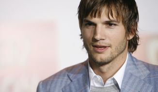 "** FILE ** Actor Ashton Kutcher poses for photographers at the premiere of ""Open Season"" in Los Angeles, in this Sept. 25, 2006, file photo. (AP Photo/Matt Sayles)"