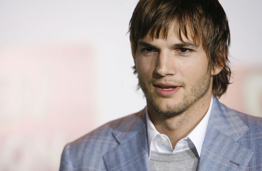 """** FILE ** Actor Ashton Kutcher poses for photographers at the premiere of """"Open Season"""" in Los Angeles, in this Sept. 25, 2006, file photo. (AP Photo/Matt Sayles)"""