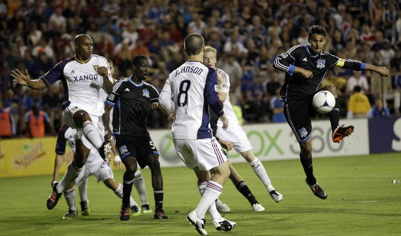 San Jose Earthquakes's Chris Wondolowski, right, controls the ball next to Real Salt Lake's Will Johnson (8) and Jamison Olave (4), far left, during the second half of a MLS soccer game in San Jose, Saturday, April 21, 2012. (AP