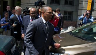Former D.C. Council member Harry Thomas Jr. makes his way to a waiting car after his sentencing at the E. Barrett Prettyman United States Courthouse in Washington, D.C., Thursday, May 3, 2012. (Rod Lamkey Jr/The Washington Times)