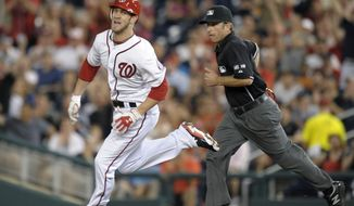 Washington Nationals Bryce Harper heads to second base on his sixth-inning RBI double that ended up sending home the winning run in the 2-1 victory over the Arizona Diamondbacks on Thursday night. (AP Photo/Susan Walsh)