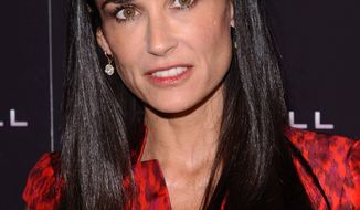 "** FILE ** In this Oct. 17, 2011, file photo, actress Demi Moore attends the premiere of ""Margin Call"" in New York. The 49-year old actress changed her Twitter name to @justdemi on Thursday, May 3, 2012. (AP Photo/Peter Kramer, File)"