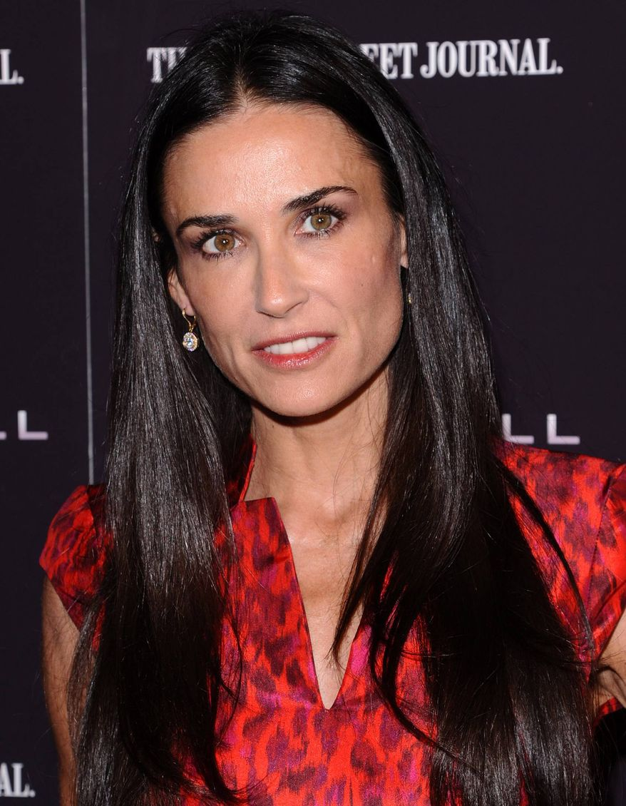 """** FILE ** In this Oct. 17, 2011, file photo, actress Demi Moore attends the premiere of """"Margin Call"""" in New York. The 49-year old actress changed her Twitter name to @justdemi on Thursday, May 3, 2012. (AP Photo/Peter Kramer, File)"""