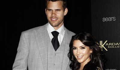 **FILE** Reality TV personality Kim Kardashian (right) and her husband, NBA basketball player Kris Humphries, arrive Aug. 17, 2011, at the Kardashian Kollection launch party in Los Angeles. (Associated Press)