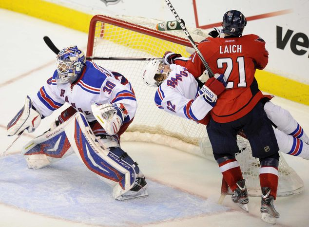Washington Capitals center Brooks Laich (21) and New York Rangers left wing Carl Hagelin (62), of Sweden, crash into the net as Rangers goalie Henrik Lundqvist (30), of Sweden, looks on during the second period of Game 4 of an NHL hockey Stanley Cup second-round playoff series, Saturday, May 5, 2012, in Washington. (AP Photo/Nick Wass)