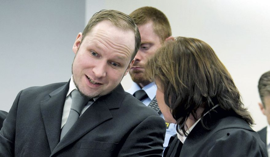 Anders Behring Breivik, left, confers with his defense lawyer Vibeke Hein Baera in the courtroom during his trial in the courthouse in Oslo, Norway Friday May 4, 2012. The far-right fanatic, who has admitted to the massacre and a bombing in Oslo on July 22, listened impassively as lawyers for the bereaved read emotional statements and showed pictures from the victims' lives alongside the coroner's autopsy reports. (AP Photo/Thomas Winje Oeijord/NTB Scanpix, Pool)