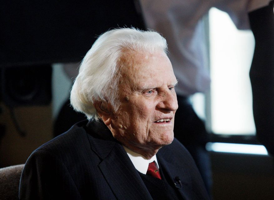 ** FILE ** The Rev. Billy Graham speaks during an interview at the Billy Graham Evangelistic Association headquarters in Charlotte, N.C., in December 2010. (Associated Press)