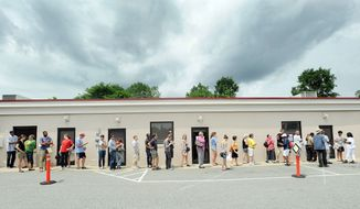A substantial number of people wait in line outside the Durham County Board of Elections building Saturday in Durham, N.C. They turned out for the last day of early voting for or against the proposed constitutional amendment to ban gay marriage in North Carolina. (Associated Press)