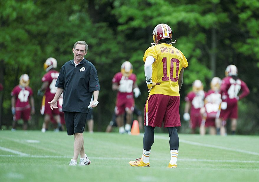 Redskins coach Mike Shanahan should have plenty of reasons to smile while trying to find ways to use Robert Griffin III against NFL defenses. (Barbara L. Salisbury/The Washington Times)