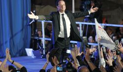 """""""I am proud to have been capable of giving people hope again,"""" President-elect Francois Hollande told huge crowds of supporters Sunday in his home area of Tulle in central France, before heading to Paris. """"We will succeed."""" (Associated Press)"""