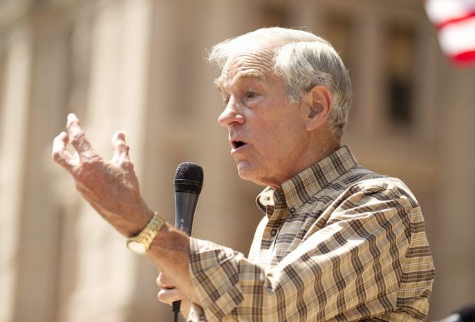 U.S. Rep. Ron Paul speaks at The Tea Party Express rally at the Capitol in Austin, Texas, on Sunday May 6, 2012. Thousands attended the event, which included speeches by Paul and U.S. Senate candidate Ted Cruz. (AP Photo/Austin American-Statesman, Jay Janner)