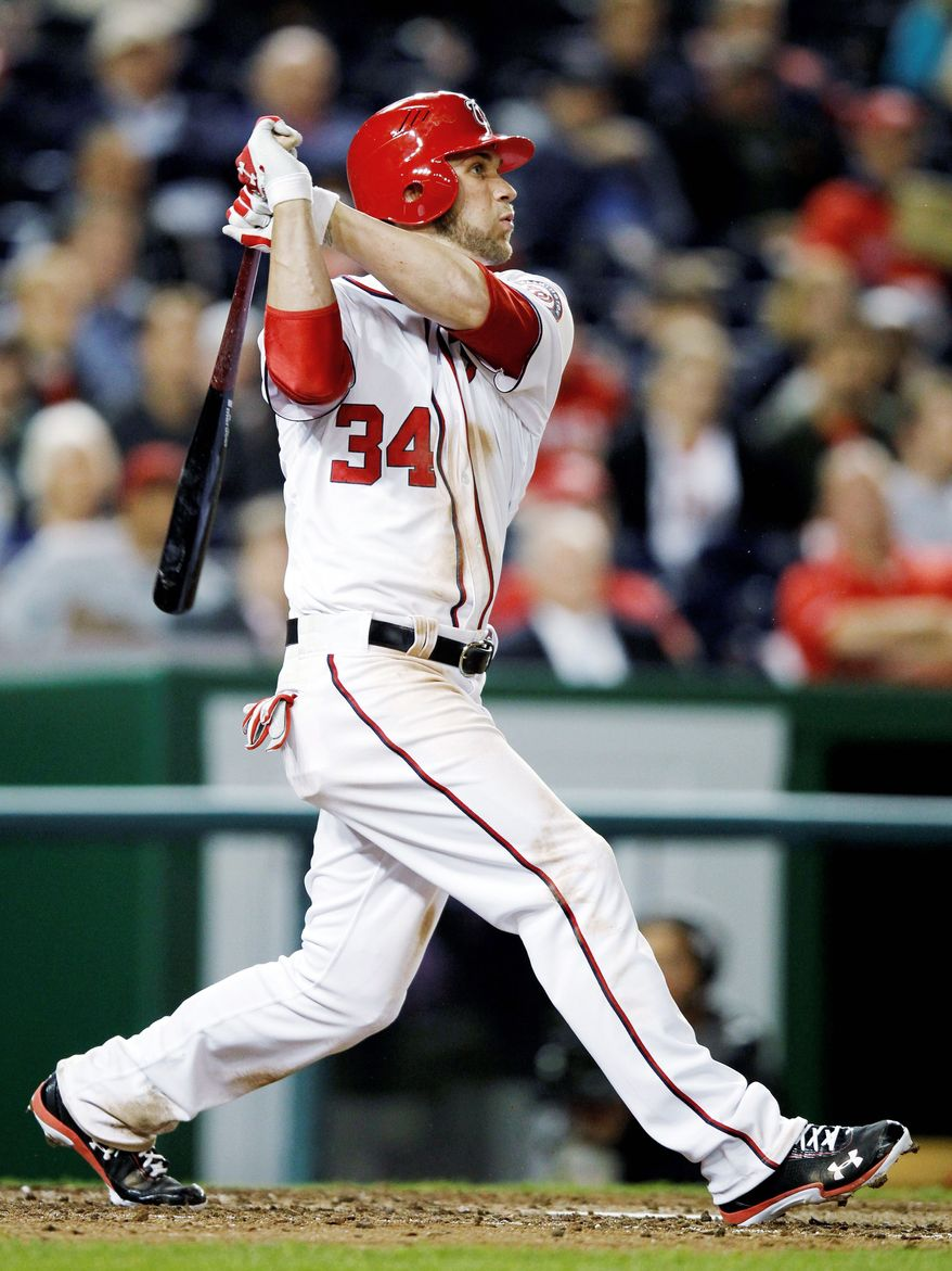 Bryce Harper entered Sunday's game against Philadelphia with four walks in his first 11 plate appearances in the series. (Associated Press)