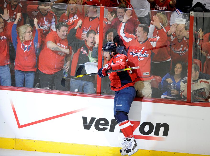 Mike Green celebrates his score in the third period of Game 4. It ended Washington's 1-for-11 slump on the power play. (Associated Press)