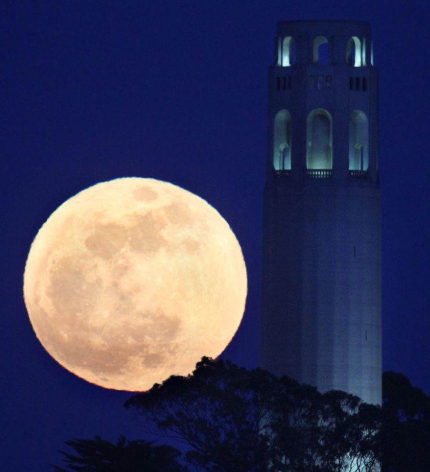 """The """"supermoon"""" rises beside the Coit Tower in San Francisco on Saturday, May 5, 2012. (AP Photo/Frederic Larson, San Francisco Chronicle)"""