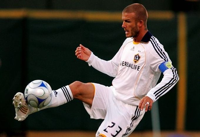 Los Angeles Galaxy's David Beckham, of England, controls the ball against the San Jose Earthquakes in the first half of a soccer game in Oakland, Calif., Saturday, June 14, 2008. (Associated Press)