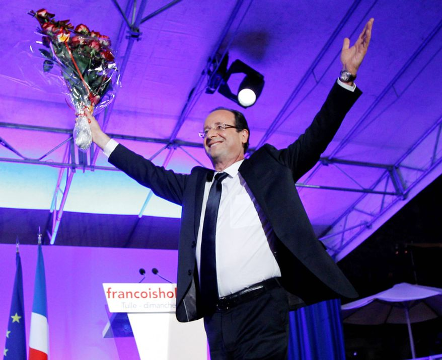 President-elect Francois Hollande holds a bouquet of roses after delivering his speech in Tulle.  Francois Hollande defeated Sarkozy on Sunday to become France's next president, Sarkozy conceded defeat minutes after the polls closed. (AP Photo/Christophe Ena)