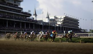 Jockey Mike Smith aboard Bodemeister leads the field around the first turn in the 138th Kentucky Derby at Churchill Downs in Louisville, Ky., on Saturday, May 5, 2012. The photo was taken with a tilt-shift lens. (AP Photo/Matt Slocum)
