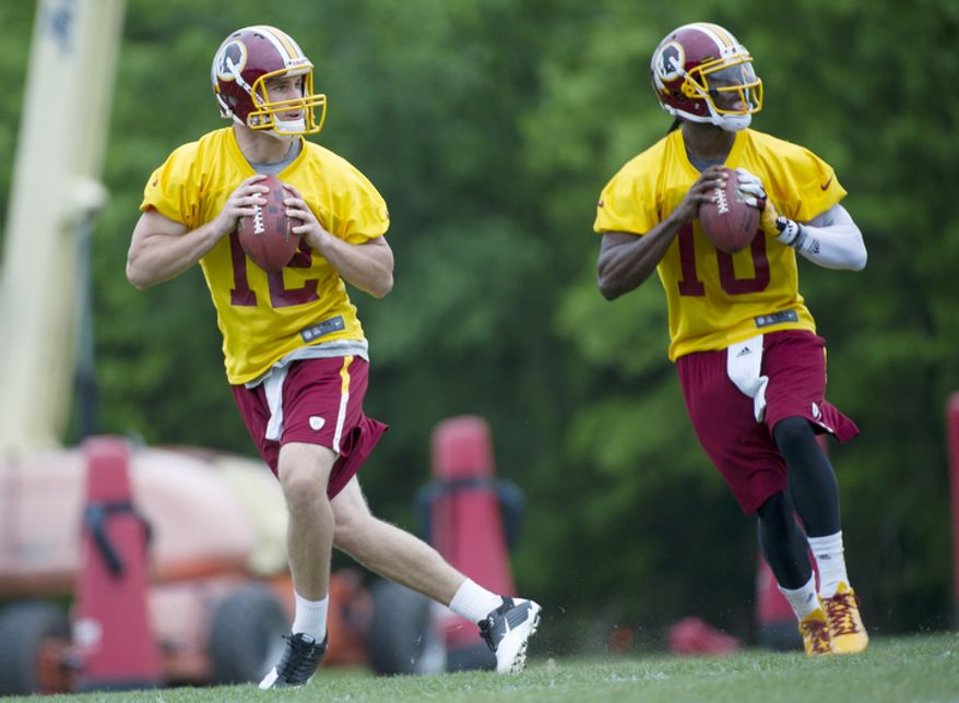 Washington Redskins quarterback drafts Kirk Cousins, left, from Michigan State and Robert Griffin III, right, from Baylor, prepare to throw the ball during drills. (Barbara L. Salisbury/The Washington Times)