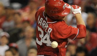Bryce Harper's response to being hit by a pitch on purpose? Two hits, including a double, and stealing home. (Associated Press)