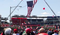 Washington's 18-10 start to the season has given fans reason to pass through the turnstiles at Nationals Park. Here, they turned out to celebrate Opening Day in D.C. on April 12. (Associated Press)