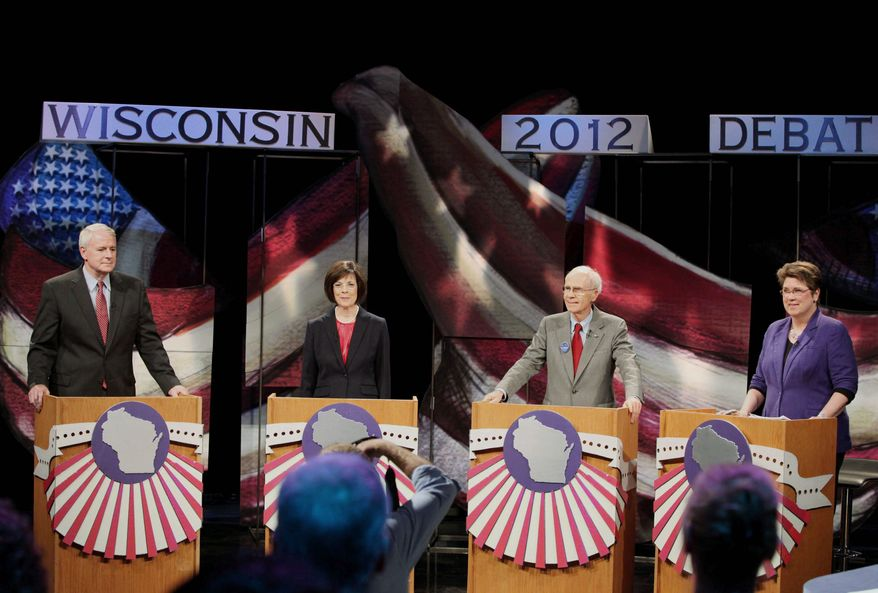 Candidates - from left, Tom Barrett, Kathleen Falk, Doug La Follette and Kathleen Vinehout - wait before the start of a live debate between Democratic candidates for Wisconsin governor at the Wisconsin Public Television studio in Madison, Wis., on Friday. The Democratic front-runners vying for a chance to take on Republican Gov. Scott Walker in a June recall election bashed the governor during the debate, accusing him of failing to create jobs and dividing the state along ideological lines. (Associated Press)