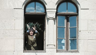 Count Graf von Faber-Castell, chairman of Faber-Castell, throws pencils from a window of the Faber-Castell Castle in Stein, Germany, to prove their durability. (Christian Burkert/Special to The Washington Times)