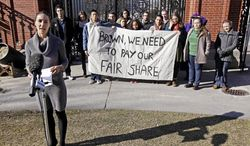 Tara Kane Prendergast (foreground), a Brown University senior from Colorado, joins fellow students at an informational protest on the Brown campus in Providence, R.I., on Friday, Feb. 10, 2012, to advocate for the school's financial support of the city. (AP Photo/Stephan Savoia, File)