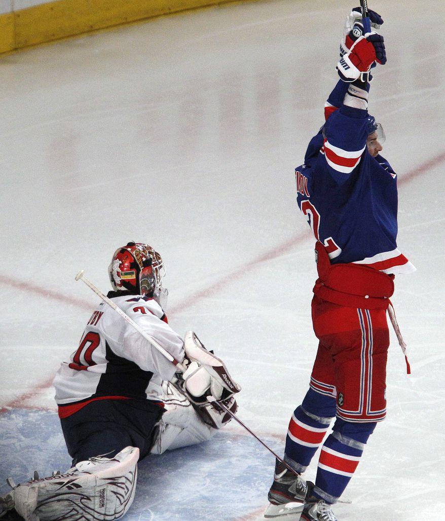 New York Rangers center Artem Anisimov celebrates after Marc Staal's overtime goal against Washington Capitals goalie Braden Holtby to give the Rangers a 3-2 victory over in Game 5 of the NHL Stanley Cup Eastern Conference semifinals, at Madison Square Garden in New York, Monday, May 7, 2012. (AP Photo/Kathy Willens)