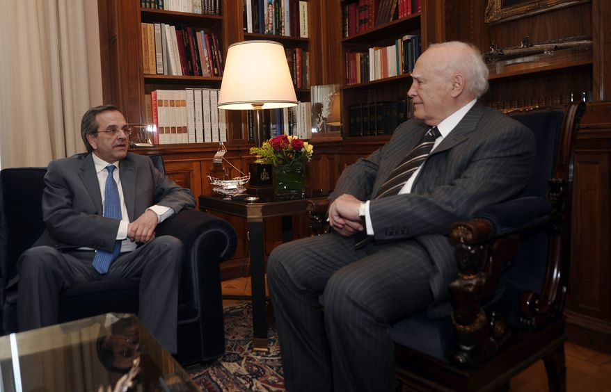 Greek President Karolos Papoulias (right) meets with Antonis Samaras, leader of the conservative New Democracy party, in Athens on Monday, May 7, 2012, to formally give Mr. Samaras the mandate to form a coalition government. (AP Photo/Aris Messinis, Pool)