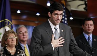 **FILE** House Budget Committee Chairman Rep. Paul Ryan (second from right), Wisconsin Republican, accompanied by fellow committee members, gestures Dec. 7, 2011, during a news conference on Capitol Hill in Washington. From left are Republican Reps. Diane Black of Tennessee, Tom Price of Georgia, Ryan, and Jason Chaffetz of Utah. (Associated Press)