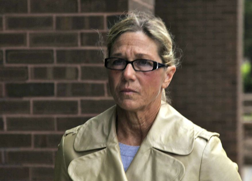 Rita Crundwell, former comptroller of Dixon, Ill., leaves federal court in Rockford, Ill., on Monday, May 7, 2012, after pleading not guilty at her arraignment to a single charge of wire fraud. (AP Photo/Robert Ray)