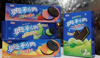 Nabisco introduced Oreos and cream-filled wafers in China in 2006, then created the country's top-selling cookie by making it smaller and less sweet and by adding new flavors such as green tea. (Associated Press)