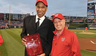 Local basketball star Adrian Dantley poses with principal owner of the Washington Nationals Mark Lerner after being inducted into the Washington DC Sports Hall of Fame on Sunday May 6, 2012. (Courtesy of the Washington Nationals)