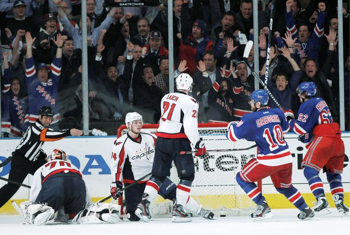 Capitals goalie Braden Holtby (left), defenseman John Carlson (middle) and Brooks Laich could only think about what might have been as Marian Gaborik celebrated Brad Richards' tying goal with 7.6 seconds left in regulation in Game 5. The Rangers won 3-2 just 1:35 into the extra session. (Associated Press)