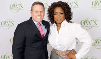 "**FILE** A photo released by Harpo Productions Inc., shows talk-show host Oprah Winfrey and David Zaslav, president and chief executive of Discovery Communications after announcing Tuesday, Jan. 15, 2008, in Chicago the formation of a new joint venture ""OWN: The Oprah Winfrey Network.""  (AP Photo/Harpo Productions Inc., George Burns)"