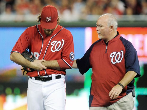 Right fielder Jayson Werth, accompanied by athletic trainer Mike McGowan, broke his left wrist during Sunday night's loss to Philadelphia. It's unrelated to an injury he suffered to the same wrist in 2005. (Associated Press)