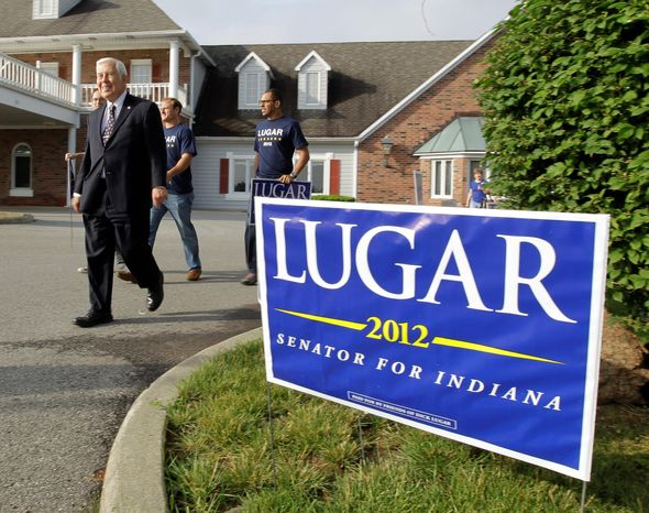 Sen. Richard G. Lugar, Indiana Republican, leaves a polling location after meeting with voters Tuesday in Greenwood, Ind. The six-term lawmaker, 80, first elected in 1976, will be leaving the Senate in January after his defeat in the GOP Senate primary Tuesday. (Associated Press)