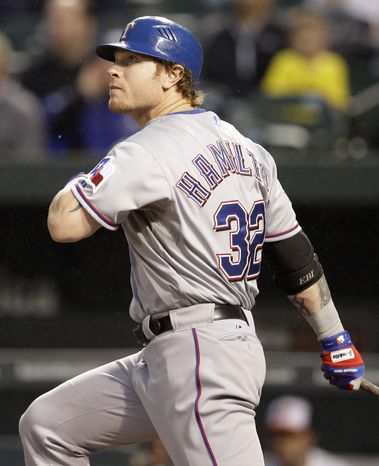 Texas Rangers' Josh Hamilton watches one of his two-run home runs in the third inning of a baseball game against the Baltimore Orioles in Baltimore on Tuesday, May 8, 2012. (AP Photo/Patrick Semansky)
