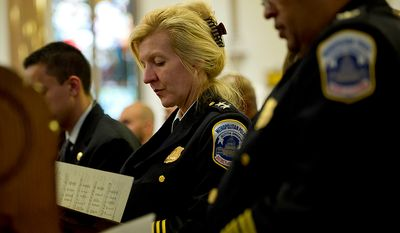 Diane Groomes, assistant chief of the Patrol Services Bureau with the Metropolitan Police Department, attends the annual Blue Mass honoring law enforcement and public safety officials Tuesday, May 8, 2012 at St. Patrick's in the City in Northwest Washington, D.C.  (Barbara L. Salisbury/The Washington Times)