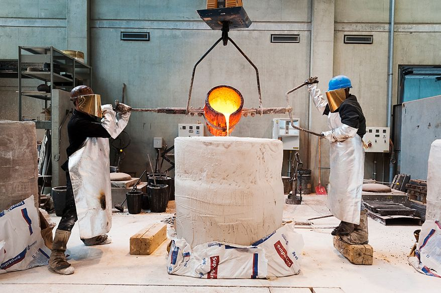 Friedrich Lehmann and Manfred Handte, employees at Noack Bronze-casting foundry, pour molten bronze into a mold.  Thursday, April 26, 2012. Noack is arguably the most important bronze-casting foundry in Germany, based in Berlin. Daniel Pilar/Special to The Washington Times