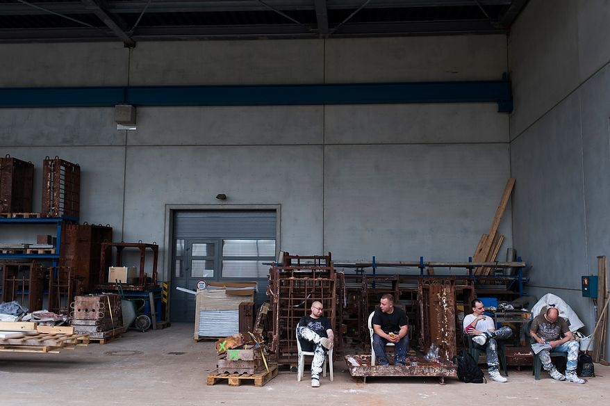 Employees havin a lunch break outside a hall of Noack, Thursday, April 26, 2012. Noack is arguably the most important bronze-casting foundry in Germany, based in Berlin.