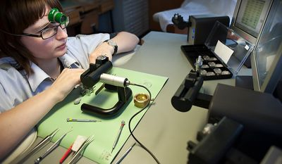 "Watchmaker Ulrike Pohl is testing and adjusting assembled movements on computer-controlled timing machines in the adjustment section (called ""reglage"") of the timepiece manufactory, the so called ""Chronometrie"", of the enterprise Nomos Glashutte, taken on Thursday, May 26, 2012. Nomos is one of only a few watchmakers worldwide with the designation of manufactory. Christian Burkert/Special to The Washington Times."