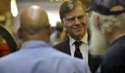 Gov. Bob McDonnell speaks with workers at Fredericksburg Machine and Steel, a family owned and run shop in Fredericksburg on Tuesday, May 8, 2012 as part of his tour of Virginia to tout it as a business friendly state. (AP Photo/The Free Lance-Star, Reza A. Marvashti)