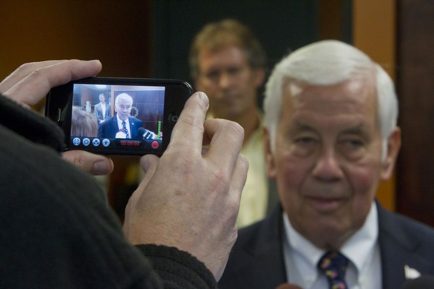 Sen. Richard G. Lugar, Indiana Republican, is video recorded by a cell phone during a visit to the West Lafayette wastewater treatment center Monday, May 7, 2012 in West Lafayette, Ind. Lugar lost Tuesday's GOP primary election to tea party candidate Richard Mourdock. (AP Photo/Journal & Courier, Michael Heinz)