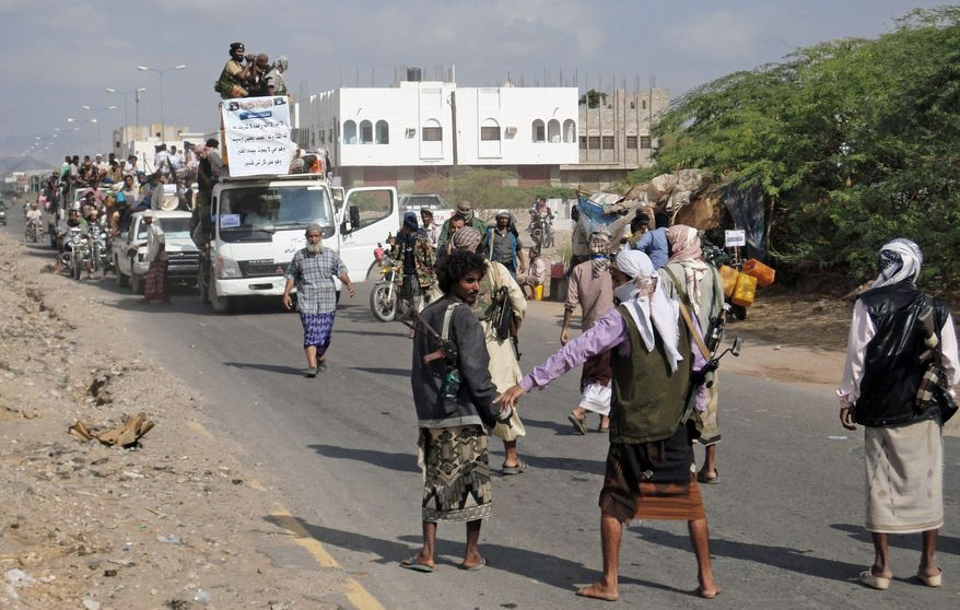 **FILE** Yemeni residents, who fled nearly eight months of fighting between the army and Islamists, return home in Zinjibar, Yemen, on Jan. 14, 2012. (Associated Press)