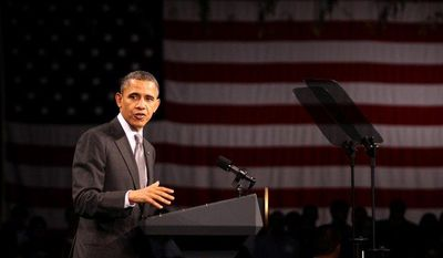 President Obama speaks at the State University of New York's Nano-Tech complex in Albany, N.Y., on Tuesday, May 8, 2012. (AP Photo/Daily Gazette, Patrick Dodson)