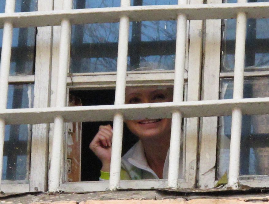 ** FILE ** Former Ukrainian Prime Minister Yulia Tymoshenko looks out from a prison window in Kiev on Friday, Nov. 4, 2011. (AP Photo/Tymoshenko Press Service)