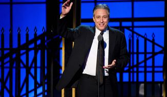 Jon Stewart appears onstage at The 2012 Comedy Awards in New York, Saturday, April 28, 2012. (AP Photo/Charles Sykes)