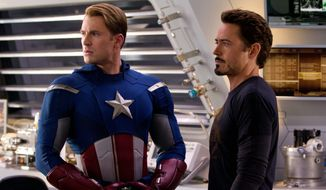 "Chris Evans (left) and Robert Downey Jr. star as Captain America and Iron Man, respectively, in ""The Avengers."" Disney is planning a sequel sometime after the release ""Iron Man 3"" and ""Thor 2"" next year and ""Captain America 2"" in 2014. (Associated Press)"