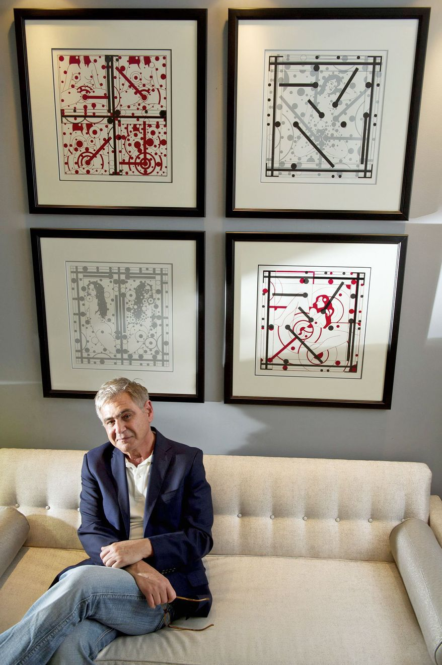 Charles Krause, a former international correspondent, starting collecting political artwork in his travels. Now he runs the Charles Krause/Reporting Fine Art gallery out of his condominium in downtown Washington. Behind him are works by Leonhard Lapin. (Barbara L. Salisbury/The Washington Times)